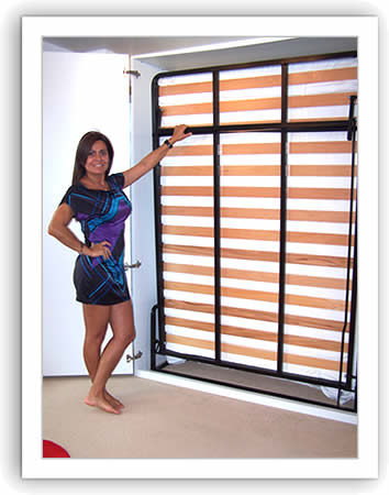 Lady beside a vertical wall bed