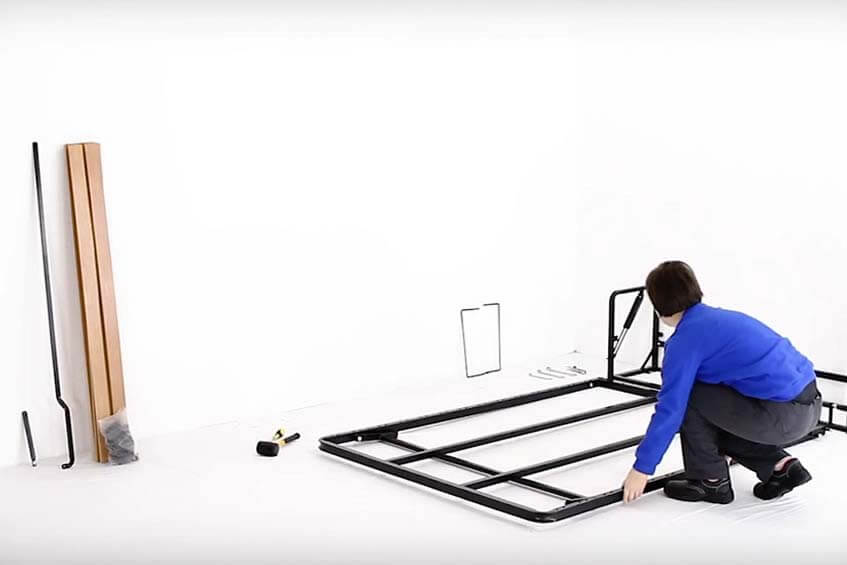 Person installing a Wall Bed King frame