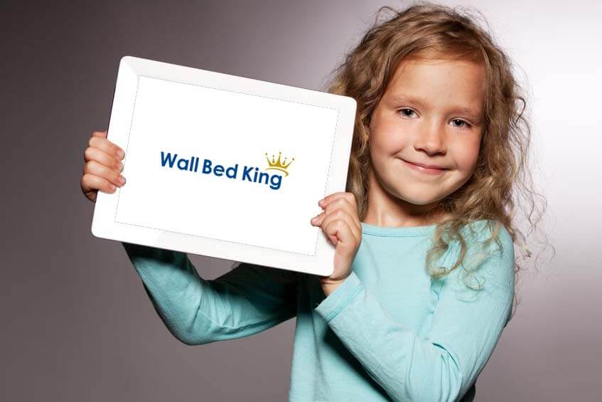 Girl holding up a tablet with Wall Bed King Reviews